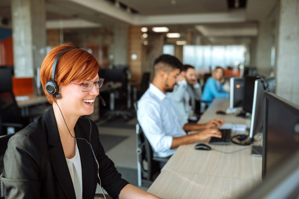 Female call center employee talking on her headset